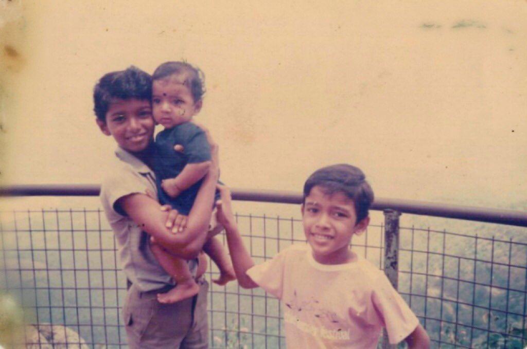 Little Vijay holding tight 6-months-old Vikranth - UNSEEN STILL