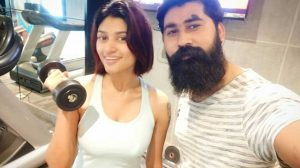 Oviya with gym trainer.